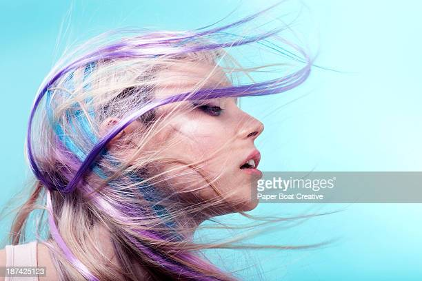 Lady with colorful hair flying over her face