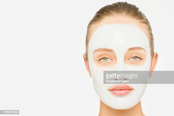 Lady with cosmetic mask over white background