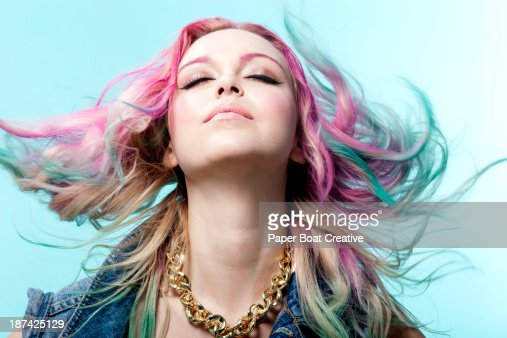Lady with multiple colored dyed hair, eyes closed