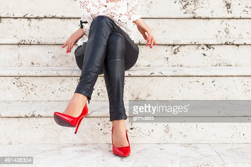 Lady with red high heel shoes : Stock Photo