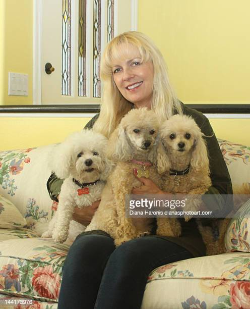 Lady with three little dogs