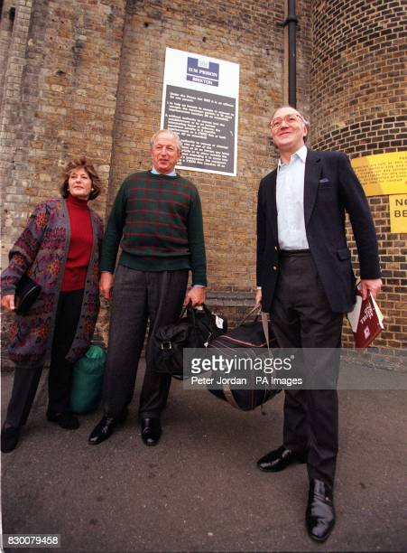 Lady Woolf Lord Woolf and former Home Secretary Michael Howard with their packed bags this morning outside Brixton Prison where they spent the night...