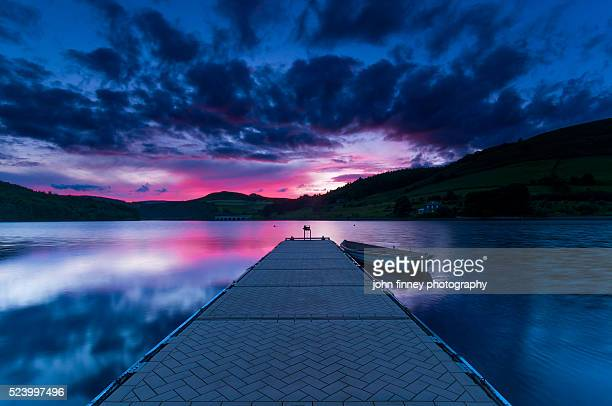 Ladybower Reservoir jetty at sunset. English Peak District.
