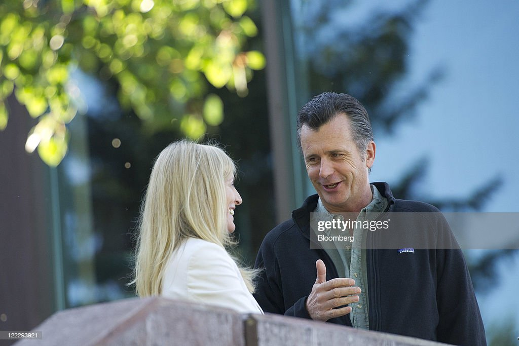 Lael Brainard, under secretary of international affairs for the U.S. Treasury Department, left, talks with Philipp Hildebrand, chairman of the Swiss National Bank, during a coffee break at an economic symposium sponsored by the Kansas City Federal Reserve Bank in Moran, Wyoming, U.S., on Saturday, Aug. 27, 2011. Federal Reserve Chairman Ben S. Bernanke said at the symposium yesterday that the central bank still has tools to stimulate the economy without providing details or signaling when or whether policy makers might deploy them. Photographer: Daniel Acker/Bloomberg via Getty Images