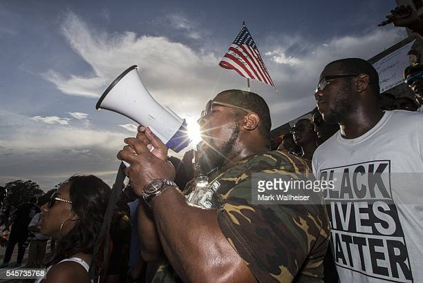 Lael Montgomery and other demonstrators gather after marching at the Louisiana Capitol to protest the shooting of Alton Sterling on July 9 2016 in...