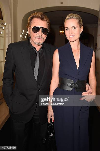 Laeticia and Johnny Hallyday attend the launch of the De Grisogono 'Crazy Skull' watch on October 23 2014 in Paris France