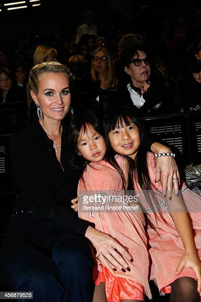 Laeticia Hallyday and her adopted daughters Joy and Jade attend the 'Reves d'Enfants' Arop charity event at Opera Bastille on December 15 2013 in...