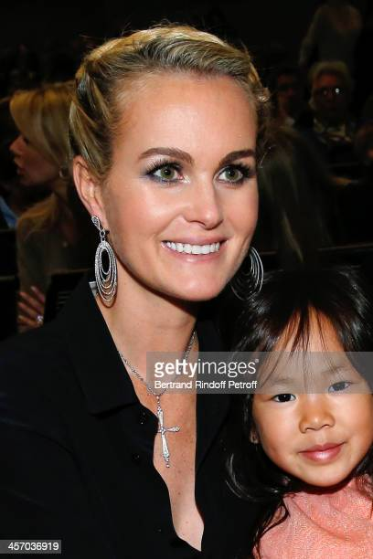 Laeticia Hallyday and her Vietnamese adopted daughter Joy attend the 'Reves d'Enfants' Arop charity event at Opera Bastille on December 15 2013 in...