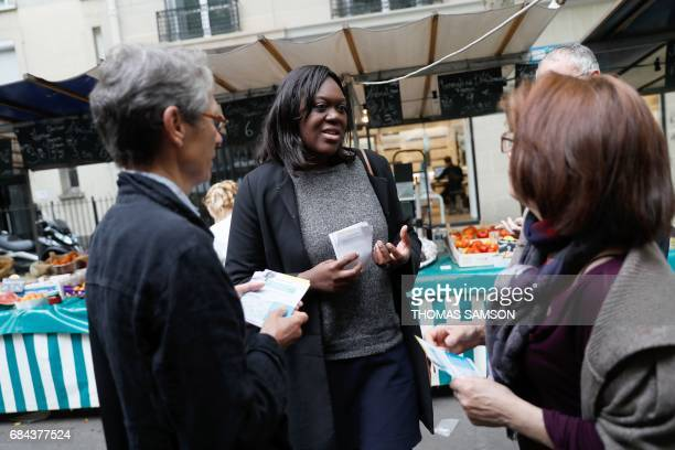 Laetitia Avia a lawyer invested by La République En Marche party for the legislative campaign speaks with members of her team as they campaign for...
