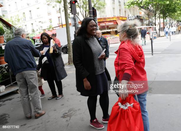 Laetitia Avia a lawyer invested by La République En Marche party for the legislative campaign speaks to a woman she campaigns for the upcoming...