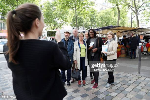 Laetitia Avia a lawyer invested by La République En Marche party for the legislative campaign poses with her team for a photograph as they campaign...