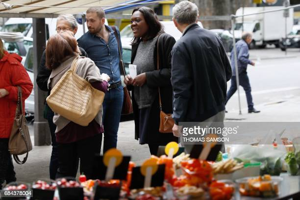 Laetitia Avia a lawyer invested by La République En Marche party for the legislative campaign holds leaflets as she campaigns for the upcoming...