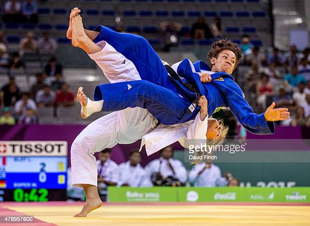 Laetitia Blot of France lifts Miryam Roper of Germany high into the air to throw her for ippon and claim one of the four wins against Germany's one...