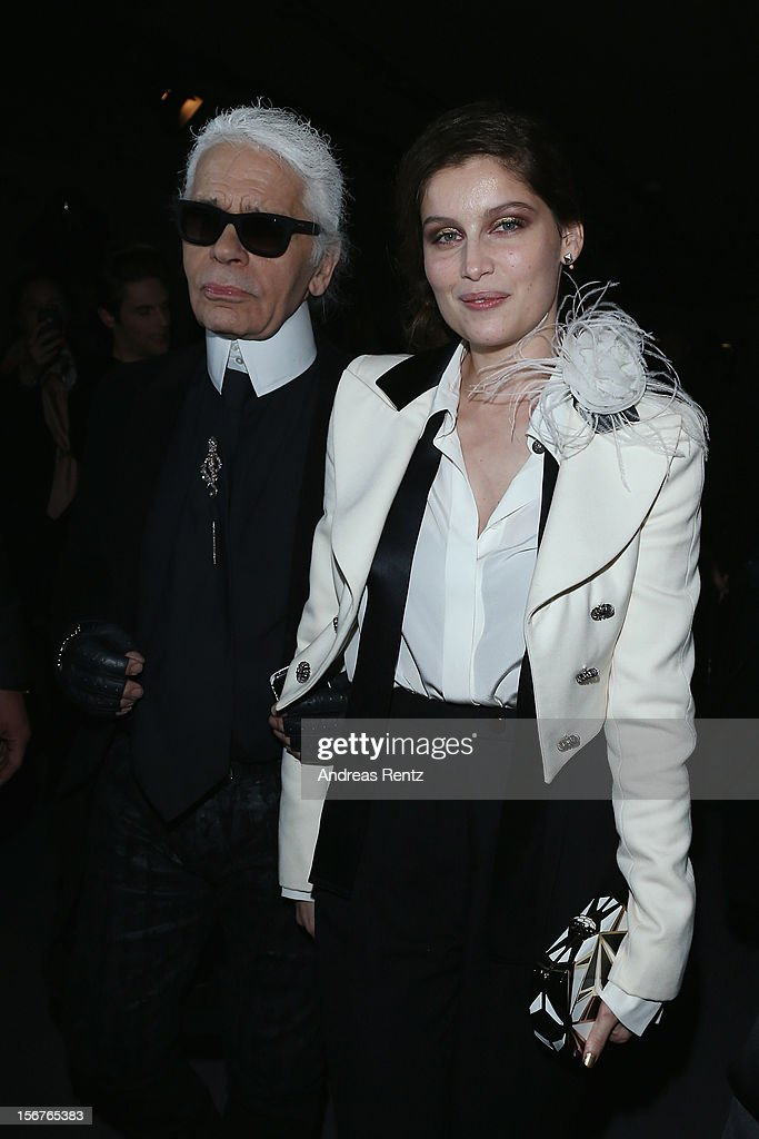 Laetitia Casta and Karl Lagerfeld arrive for the CHANEL 'The Little Black Jacket' - Exhibition Opening by Karl Lagerfeld and Carine Roitfeld on November 20, 2012 in Berlin, Germany.