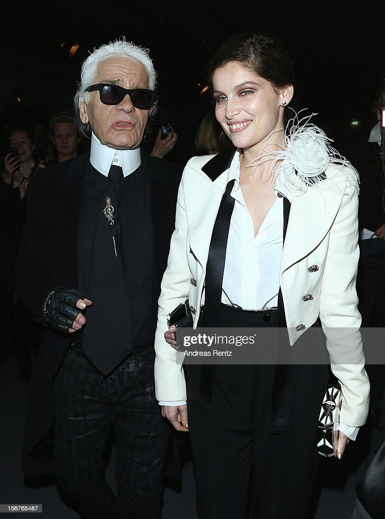 <a gi-track='captionPersonalityLinkClicked' href=/galleries/search?phrase=Laetitia+Casta&family=editorial&specificpeople=203075 ng-click='$event.stopPropagation()'>Laetitia Casta</a> and Karl Lagerfeld arrive for the CHANEL 'The Little Black Jacket' - Exhibition Opening by Karl Lagerfeld and Carine Roitfeld on November 20, 2012 in Berlin, Germany.