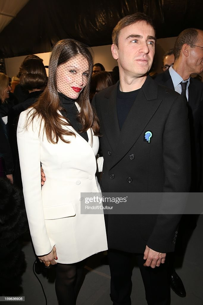 <a gi-track='captionPersonalityLinkClicked' href=/galleries/search?phrase=Laetitia+Casta&family=editorial&specificpeople=203075 ng-click='$event.stopPropagation()'>Laetitia Casta</a> and <a gi-track='captionPersonalityLinkClicked' href=/galleries/search?phrase=Raf+Simons+-+Fashion+Designer&family=editorial&specificpeople=7070305 ng-click='$event.stopPropagation()'>Raf Simons</a> attend in Backstage the Christian Dior Spring/Summer 2013 Haute-Couture show as part of Paris Fashion Week at on January 21, 2013 in Paris, France.