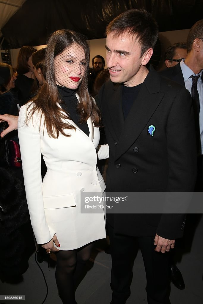 Laetitia Casta and Raf Simons attend in Backstage the Christian Dior Spring/Summer 2013 Haute-Couture show as part of Paris Fashion Week at on January 21, 2013 in Paris, France.