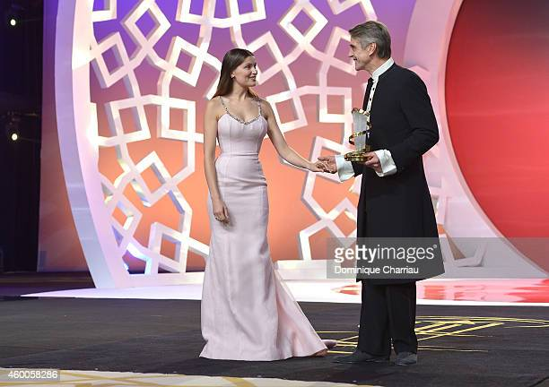 Laetitia Casta presents Jeremy Irons with a tribute award during the Evening Tribute To Jeremy Irons as part of the 14th Marrakech International Film...