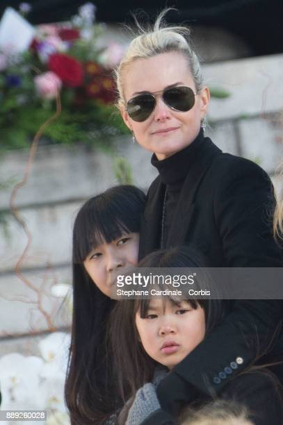 Laetitia Hallyday with her daughters Jade Hallyday and Joy Hallyday during Johnny Hallyday's Funeral at Eglise De La Madeleine on December 9 2017 in...