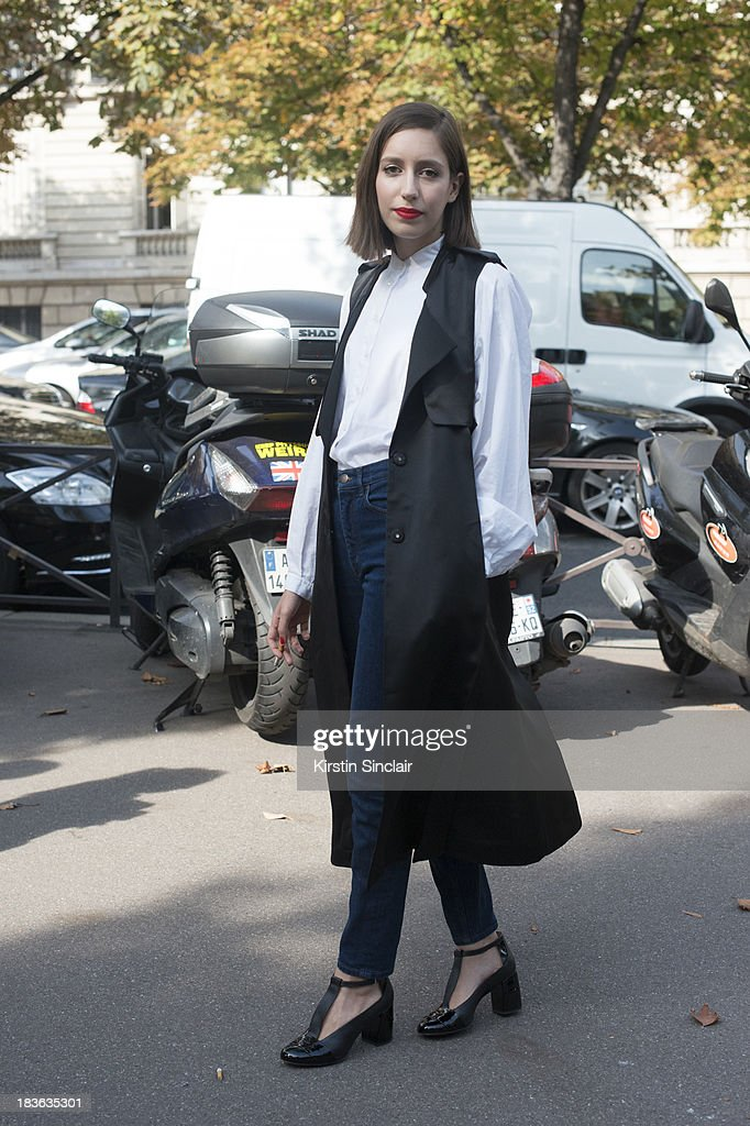 Laetitia Roukbi wearing Cos jeans, Kenzo shirt, Robert Clergerie shoes and an H and M coat on day 9 of Paris Fashion Week Spring/Summer 2014, Paris October 02, 2013 in Paris, France.