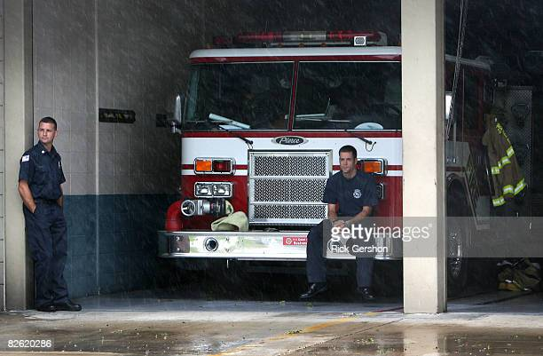 Lafayette firefighters Kelly Patin and Sean Lirette watch as the effects of Hurricane Gustav were just beginning to be felt with increasing winds and...
