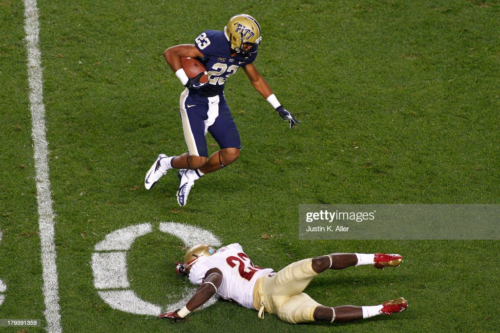 Lafayette Pitts #23 of the Pittsburgh Panthers leaps over Telvin Smith #22 of the Florida State Seminoles during the game on September 2, 2013 at Heinz Field in Pittsburgh, Pennsylvania.