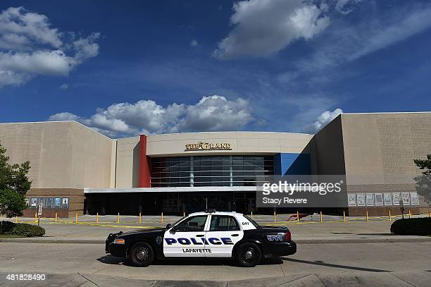 Lafayette police guard the Grand Theatre on July 24 2015 in Lafayette Louisiana Two people were killed and nine others wounded when a shooter...