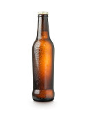 shot of a beer or lager bottle on a white background with droplets of water and copy space for the designer