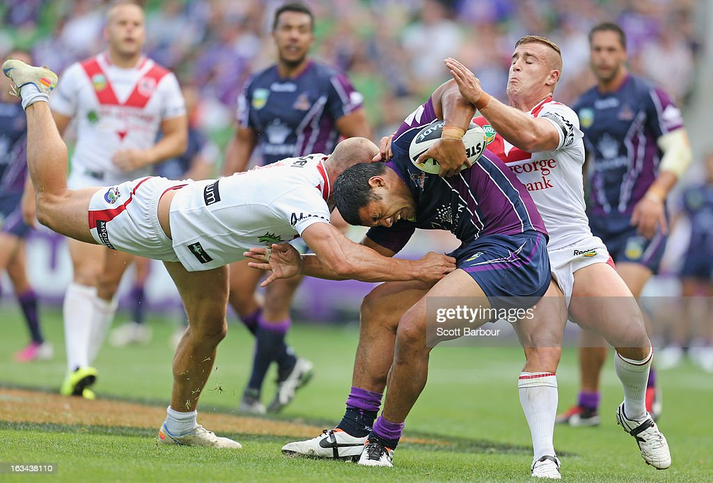 Lagi Setu of the Storm is tackled during the round one NRL match between the Melbourne Storm and the St George Illawarra Dragons at AAMI Park on March 10, 2013 in Melbourne, Australia.