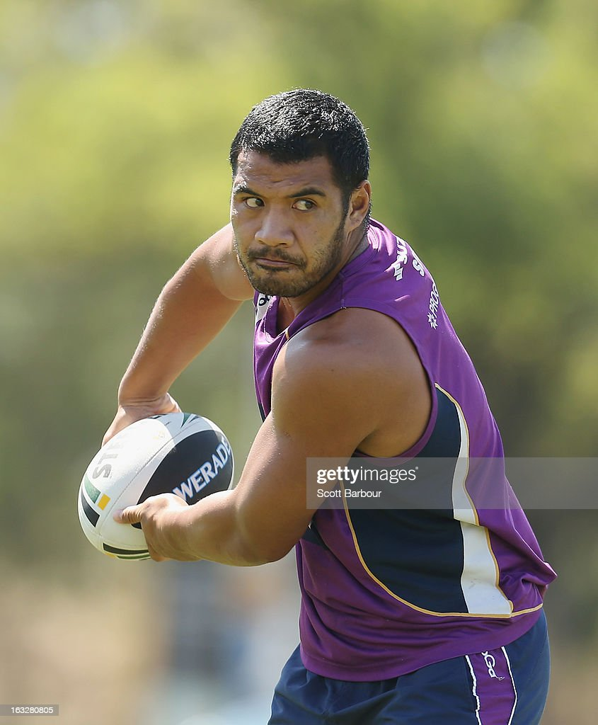 Lagi Setu of the Storm passes the ball during a Melbourne Storm NRL training session at Gosch's Paddock on March 7, 2013 in Melbourne, Australia.