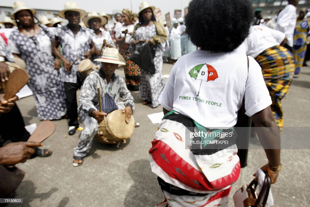 A female member of the Niger Delta cultural group dances to a drummer during a rally held by Peoples Democratic Party in support of presidential candidate Goodluck Jonathan, who is an indigene of the crisis torn region, in Lagos Saturday 27 January, 2007. Nigerian police were out in force Saturday as the ruling Peoples Democratic Party kicked off its campaign for April elections in the opposition stronghold of Lagos.