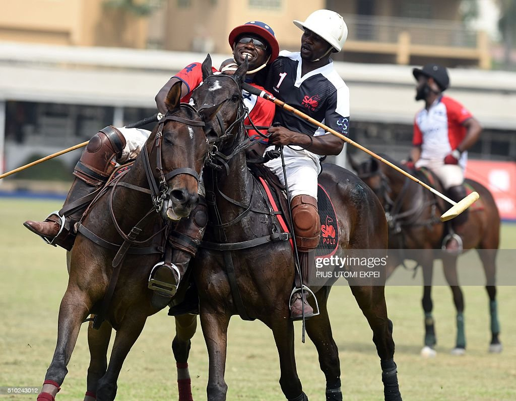 Lagos Sao Polo player (R) hugs a Lagos STL player to celebrate his team's victory after a match during the Lagos polo tournament on February 14, 2016, in Lagos. The Lagos Polo tournament is a hub for influential people attracting polticians, businessmen and professional players, at two week long event in which the competition isinterspersed with fashion shows, painting exhibitions and hat contests. / AFP / PIUS UTOMI EKPEI