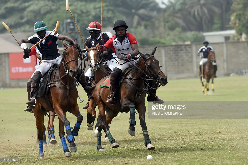 Lagos Sao Polo's and Lagos STL's players chase the ball during the annual Lagos polo tournament on February 14, 2016, in Lagos. The Lagos Polo tournament is a hub for influential people attracting polticians, businessmen and professional players, at two week long event in which the competition isinterspersed with fashion shows, painting exhibitions and hat contests. / AFP / PIUS UTOMI EKPEI