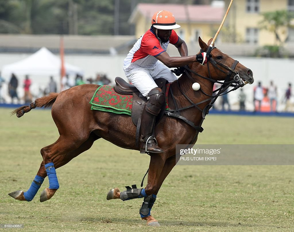 Lagos STL player tries to clear the ball during the Lagos polo tournament on February 14, 2016, in Lagos. The Lagos Polo tournament is a hub for influential people attracting polticians, businessmen and professional players, at two week long event in which the competition isinterspersed with fashion shows, painting exhibitions and hat contests. / AFP / PIUS UTOMI EKPEI