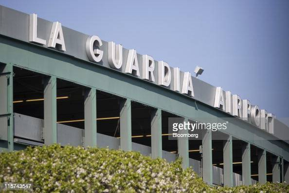 LaGuardia Airport signage is displayed on a parking garage in the Queens borough of New York US on Monday April 25 2011 American Airlines Inc is...