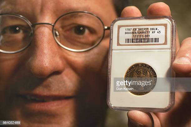 A Laguna man Steven Contursi holds the 1787 Brasher Doubloon he recently purchased for 3 million dollars The coin was hand struck in 1787 by George...