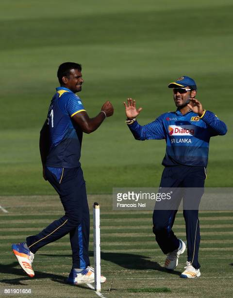 Lahiru Gamage celebrates after dismissing Mohammad Hafeez of Pakistan during the second One Day International match between Pakistan and Sri Lanka at...