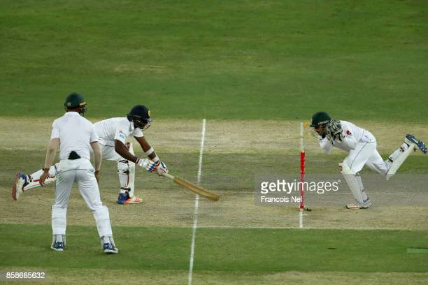 Lahiru Gamage of Sri Lanka is stumped by Sarfraz Ahmed of Pakistan during Day Two of the Second Test between Pakistan and Sri Lanka at Dubai...