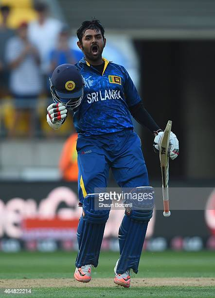 Lahiru Thiramanna of Sri Lanka celebrates after reaching his century during the 2015 ICC Cricket World Cup match between England and Sri Lanka at...