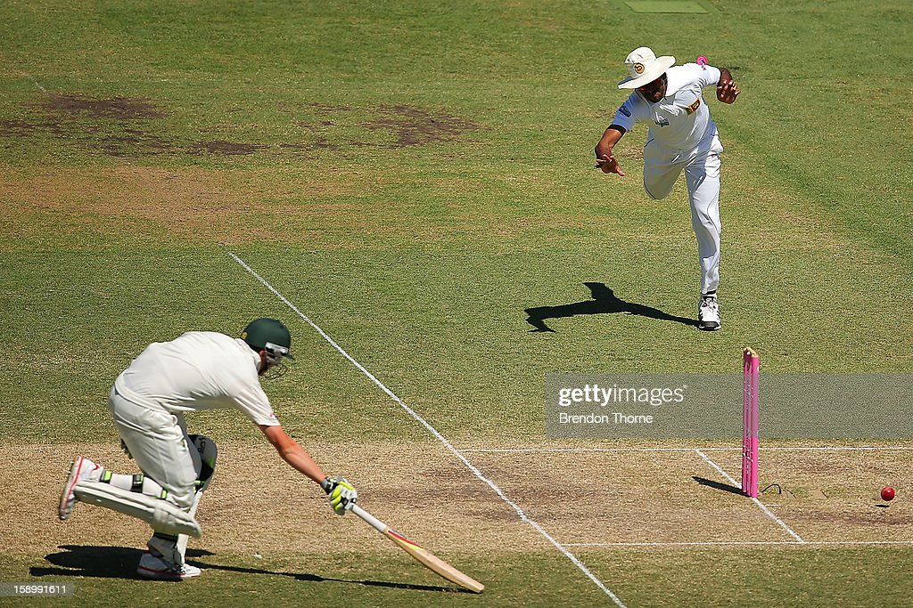 Lahiru Thirimanne of Sri Lanka attempts to run out Peter Siddle of Australia during day three of the Third Test match between Australia and Sri Lanka at the Sydney Cricket Ground on January 5, 2013 in Sydney, Australia.