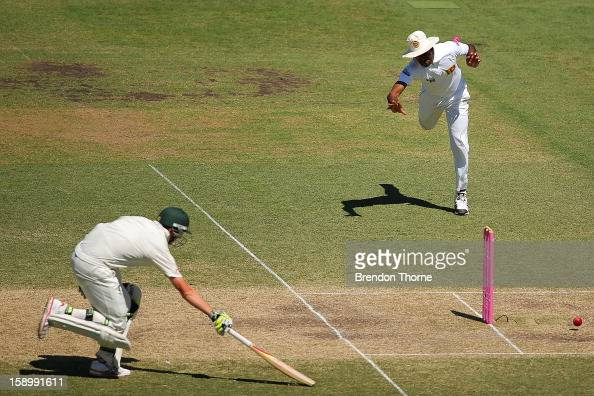 Lahiru Thirimanne of Sri Lanka attempts to run out Peter Siddle of Australia during day three of the Third Test match between Australia and Sri Lanka...