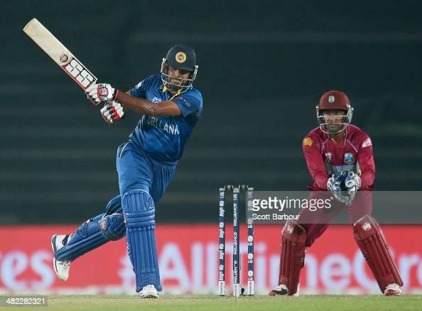 Lahiru Thirimanne of Sri Lanka bats as Denesh Ramdin of the West Indies looks on during the ICC World Twenty20 Bangladesh 2014 1st SemiFinal match...