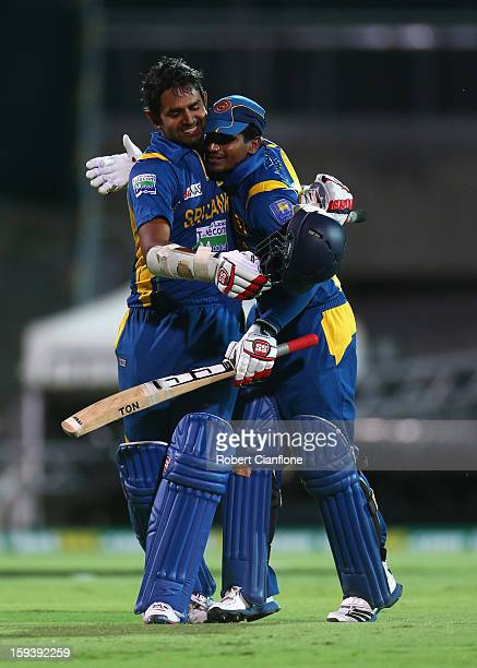 Lahiru Thirimanne of Sri Lanka celebrates with Kushal Janith Perera after scoring the winning runs and his century during game two of the...