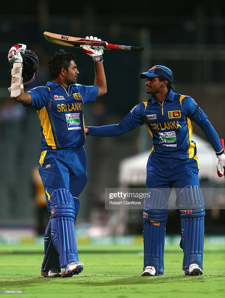 <a gi-track='captionPersonalityLinkClicked' href=/galleries/search?phrase=Lahiru+Thirimanne&family=editorial&specificpeople=5946377 ng-click='$event.stopPropagation()'>Lahiru Thirimanne</a> of Sri Lanka celebrates with Kushal Janith Perera after scoring the winning runs and his century during game two of the Commonwealth Bank One Day International series between Australia and Sri Lanka at Adelaide Oval on January 13, 2013 in Adelaide, Australia.