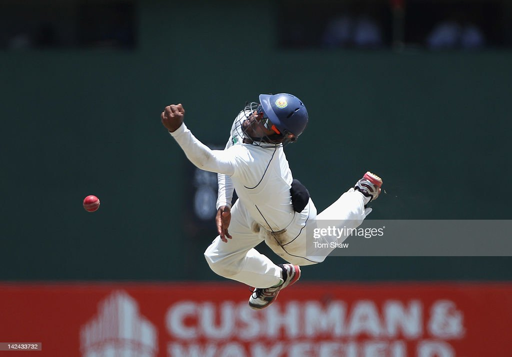 <a gi-track='captionPersonalityLinkClicked' href=/galleries/search?phrase=Lahiru+Thirimanne&family=editorial&specificpeople=5946377 ng-click='$event.stopPropagation()'>Lahiru Thirimanne</a> of Sri LAnka dives in vain off a chance from <a gi-track='captionPersonalityLinkClicked' href=/galleries/search?phrase=Kevin+Pietersen+-+Cricket+Player&family=editorial&specificpeople=202001 ng-click='$event.stopPropagation()'>Kevin Pietersen</a> of England during day 3 of the 2nd test match between Sri Lanka and England at the P Sara Stadium on April 5, 2012 in Colombo, Sri Lanka.