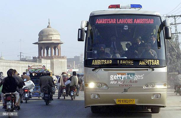 A bus carrying Indian and Pakistani officials and coming from Amritsar in India's northern state of Punjab arrives in Lahore after crossing the...