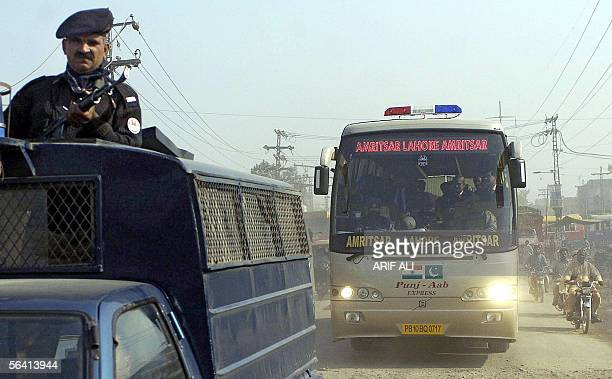 A Pakistani police van escorts a bus carrying Indian and Pakistani officials and coming from Amritsar in India's northern state of Punjab as it...