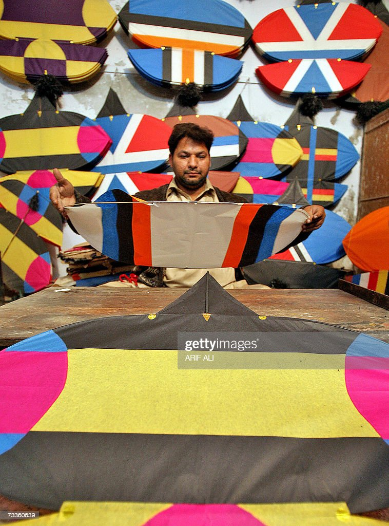 A Pakistani shopkeeper makes new kites at a kite shop in Lahore, 18 February 2007, on the eve of The Basant Festival. Pakistani authorities have lifted a ban on the annual kite-flying festival of Basant, which often ends in tragedy because of the razor-sharp cords used. The Punjab government has allowed the celebration of Basant festival in Lahore and other parts of the province on 24 and 25 February. AFP PHOTO/Arif ALI