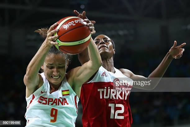 Laia Palau of Spain and Lara Sanders of Turkey contest the ball during the Women's Quarterfinal match between Spain and Turkey at Carioca Arena 1 on...