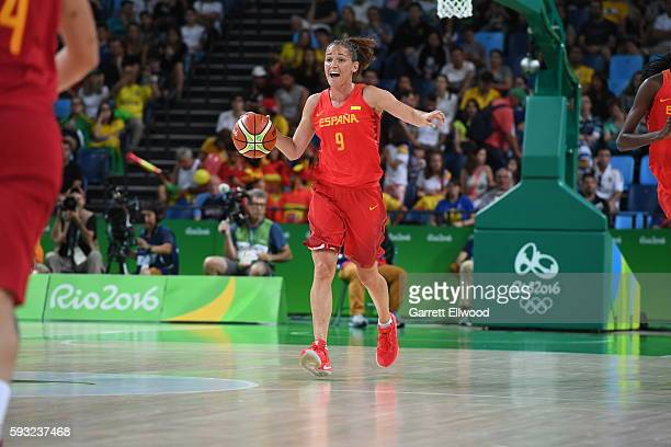Laia Palau of Spain brings the ball up court against the USA Women's National Basketball Team during the Gold Medal Game on Day 15 of the Rio 2016...